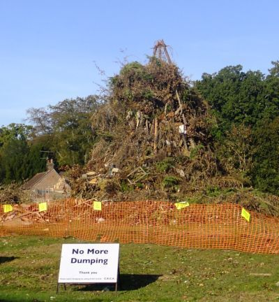 bonfire nearly complete with no dumping sign