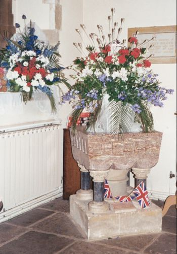Flowers in church - in Font