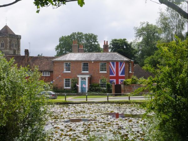 House by village pond with BIG Union Jack