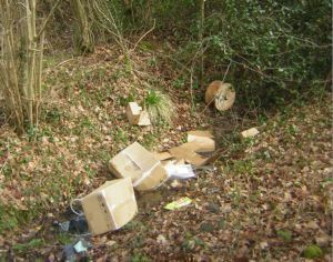 cardboard boxes , cabel drum in ditch