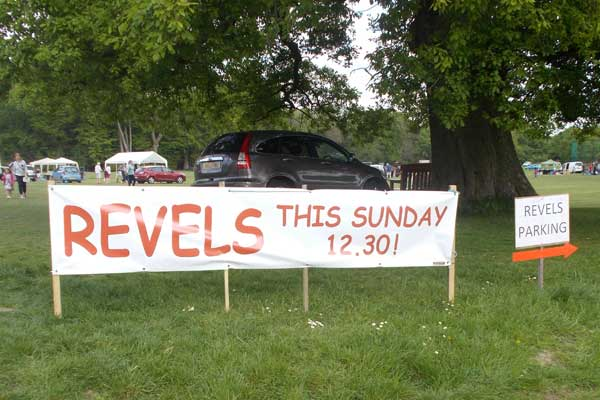 Large Revels  poster by oak tree at fete site