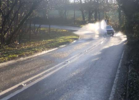 Car going through water at Anstead Brook